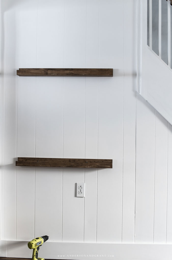 Two picture ledge shelves on white wall