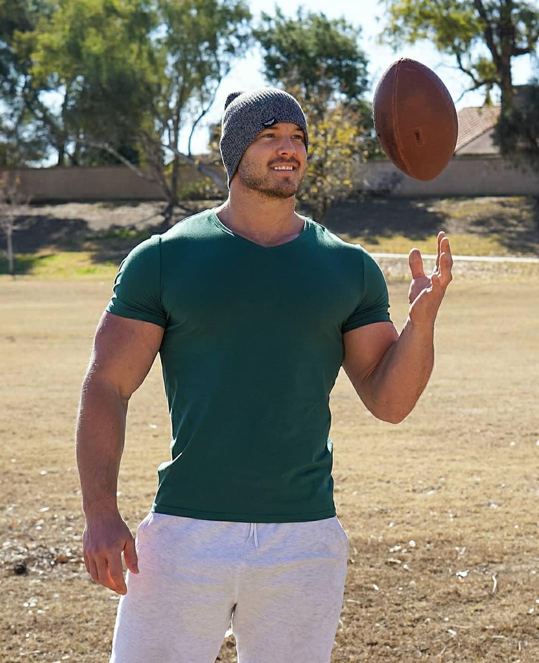 smiling-beefcake-hunk-rugby-ball