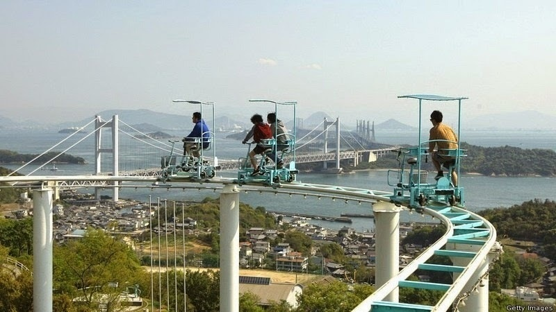 At the Washuzan Highland Amusement Park in Okayama, Japan, you will find the SkyCycle, a roller coaster in which passengers are required to pedal a course four stories high. - Japan's Pedal Powered Roller Coaster Is The Most Unintentionally Terrifying Ride Ever.