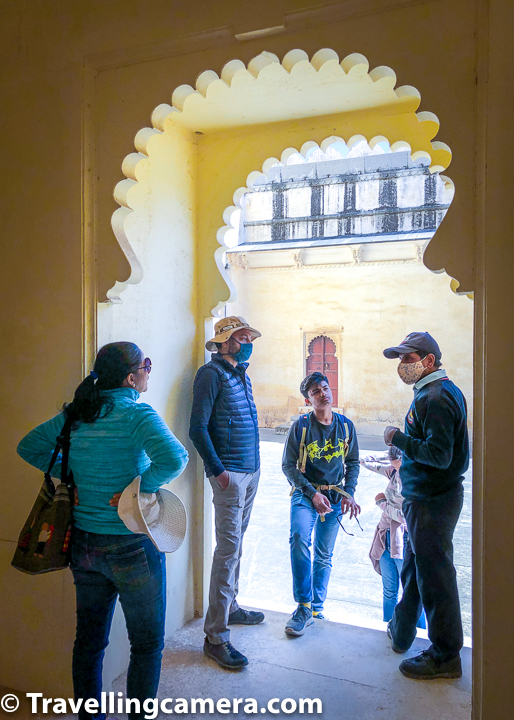 The security guard at Mardana Mahal was kind enough to share some interesting facts and stories about Mardana Mahal of Badal Mahal. Above photograph shows how much the group was focussed to hear him. Certainly he was a good story teller and knew enough about the space he was guarding for tourists at Kumbalgarh Fort in Rajasthan. Such people make your travel experiences even more beautiful.