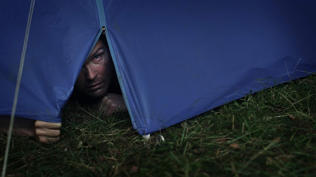 man in a tent
