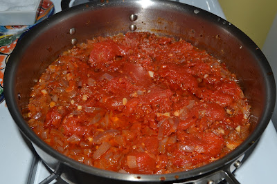 After an hour, tomato sauce will be reduced.