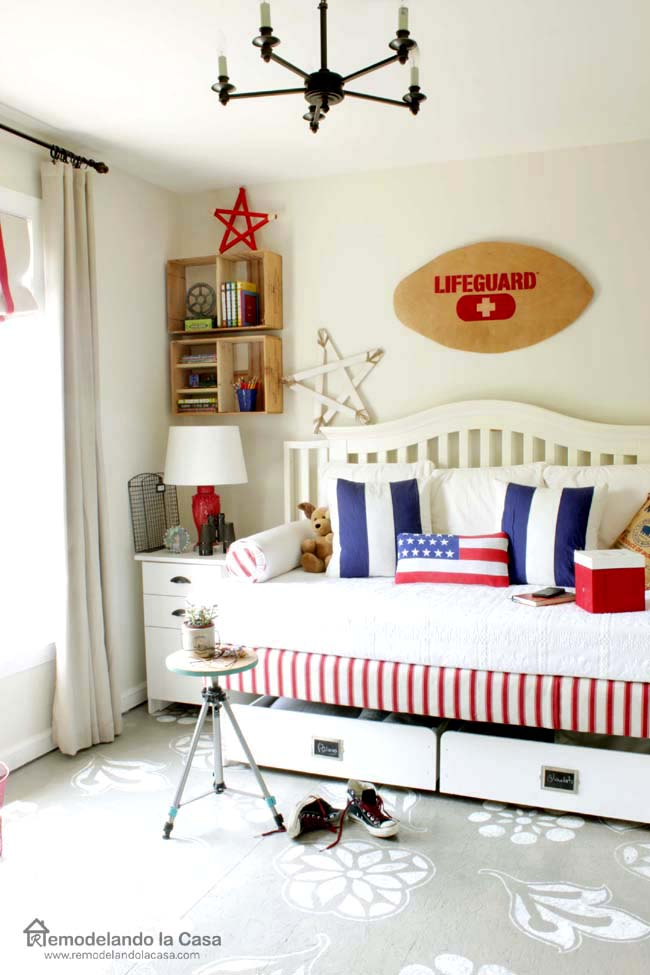 bedroom with Lifeguard decor sign ski board, flag pillow and wooden stars
