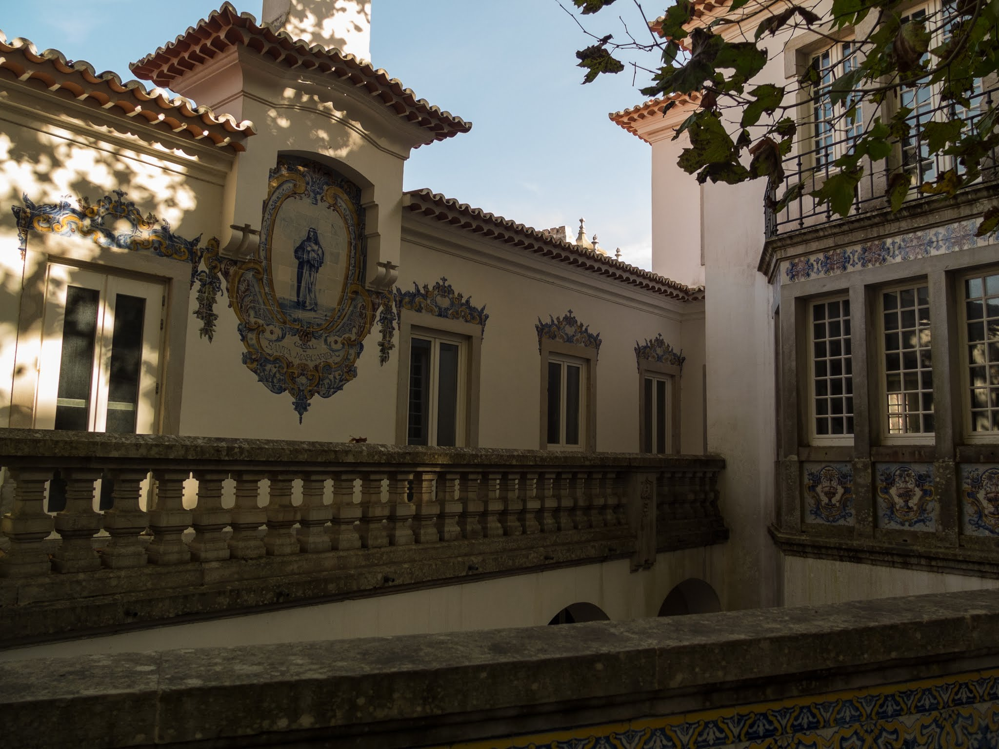 A tile decorated building in the shade in Sintra, Portugal.