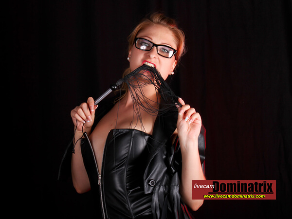 MONICASS on livecamdominatrix redhead Domme with flogger wearing black corset