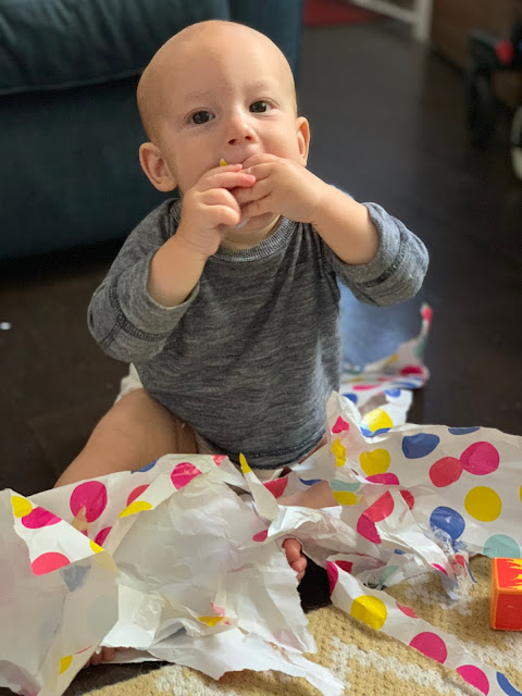 Baby Boy eating spotty wrapping paper