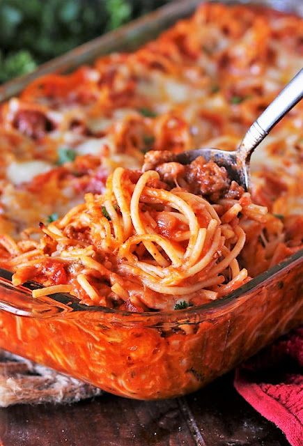 Serving Spoon of Baked Spaghetti Image