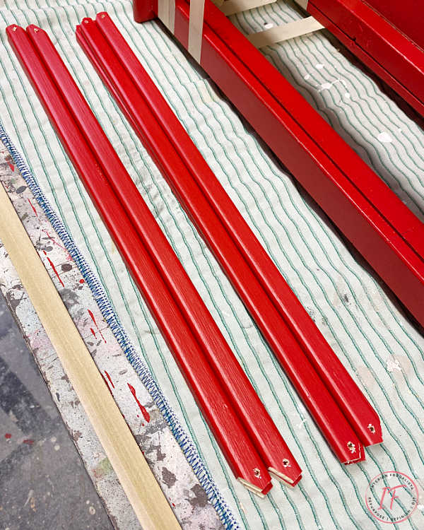 How to build large outdoor festive red lanterns with scrap wood set on timers for budget-friendly front porch Christmas decor with farmhouse style.