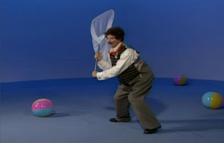 Mr. Noodle brings a butterfly net this time to catch the balls. Elmo's World Balls The Noodle Family