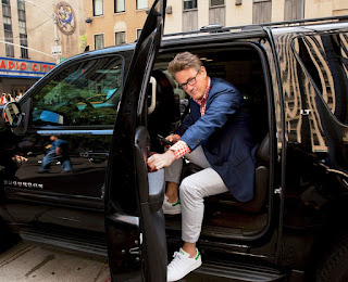 Joe Scarborough coming out of a car