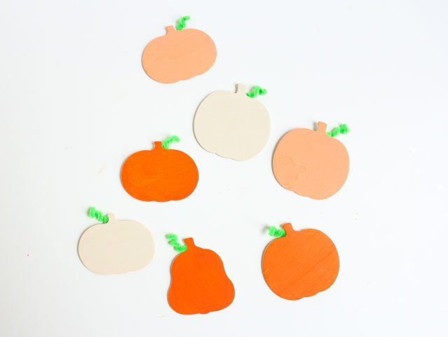 Painted wood pumpkins with pipe cleaner stems!