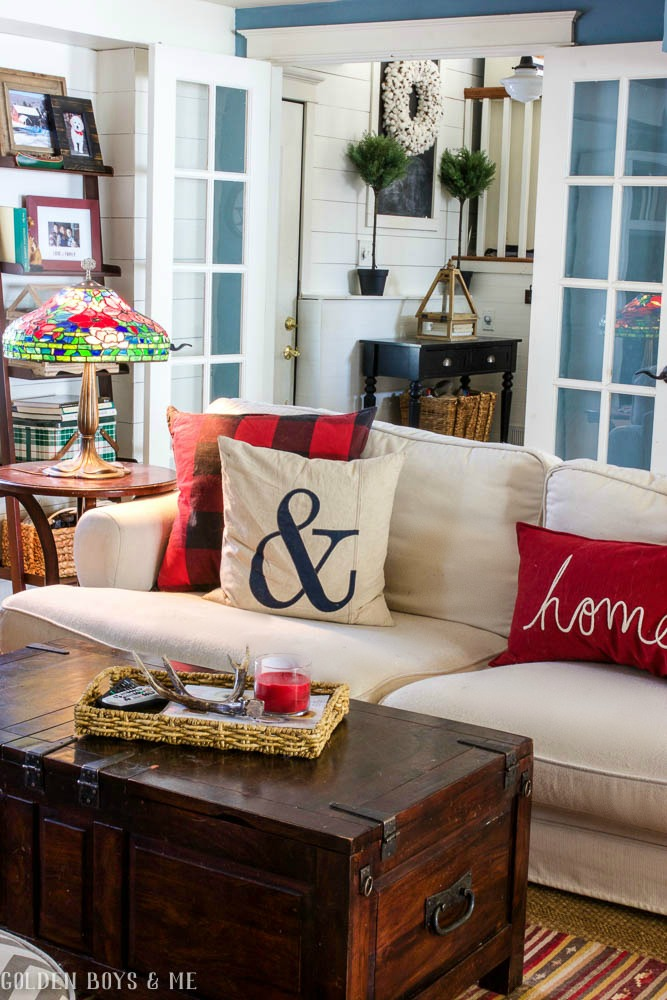 Pottery Barn plaid throw pillows on Ikea slipcovered sofa