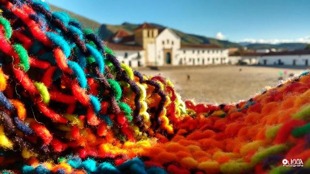 Tejido en lana virgen y al fondo la iglesia de Villa de Leyva