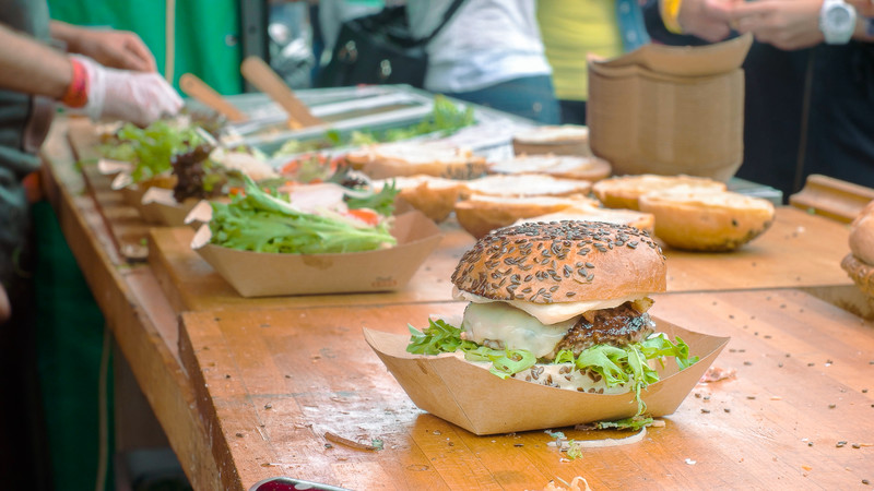 Burgers being made at a food festival