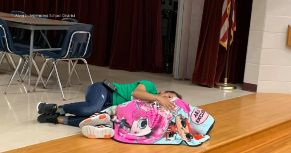 School Custodian Shows Ultimate Compassion As She Lies Down & Hug A Student Having A Rough Day