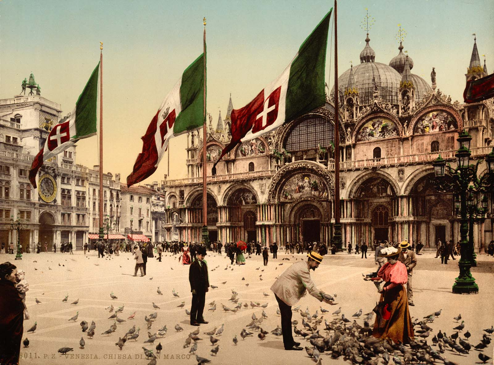 A scene of pigeon-feeding in St. Mark's Piazza.