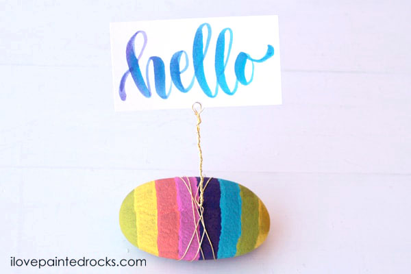 Take painted rocks to the next level by turning them into photo displays.