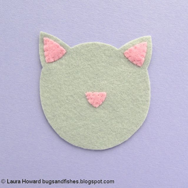 add the ears and news to the felt cat