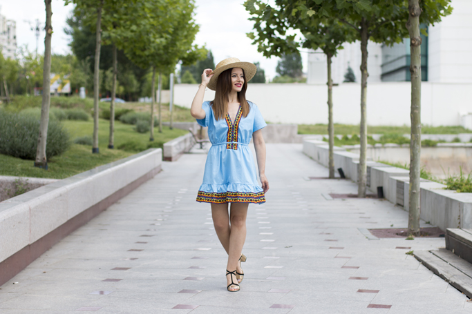 the blue dress with embroidery