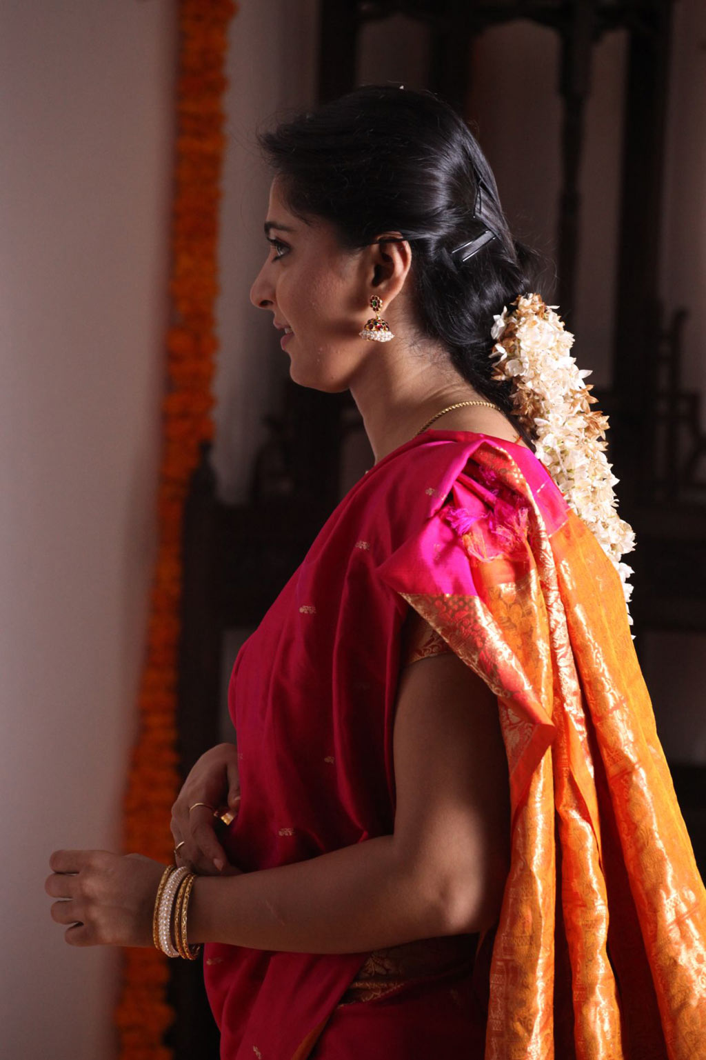 Indian Girl Anushka Shetty Long Hair Stills In Red Traditional Saree