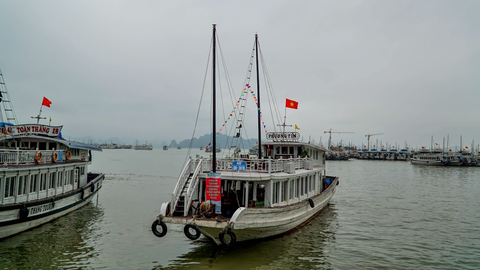 A junk departing the wharf for Halong Bay