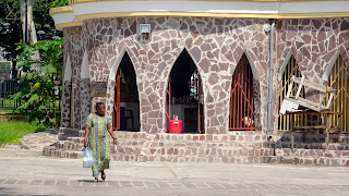 She walks outside the church in Brazzaville