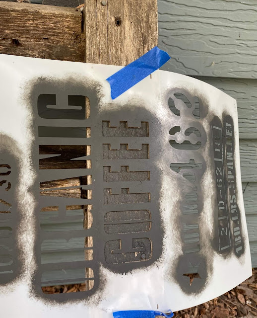 Photo of a stencil taped to a ladder side