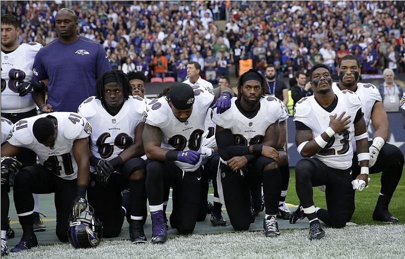 American Football Stars Drop to their knees