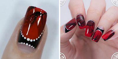 finalizar a decoração de unhas com esmalte vermelho