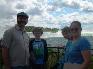 The four of us with the horseshoe falls behind us.