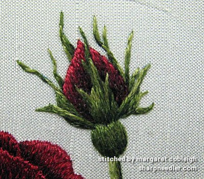 Detail of thread painted rosebud in silk and cotton threads (design by Trish Burr)