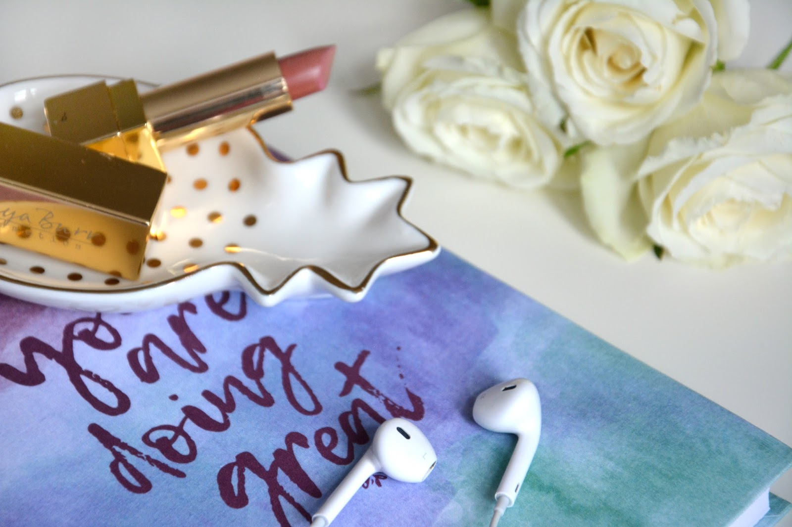 White Roses; Apple EarPods; Maisons Du Monde Pineapple Trinket Dish, Hema Notebook; Tanya Burr Cosmetics Lipstick Pink Cocoa