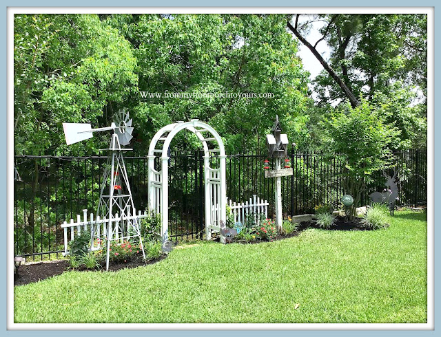 Backyard-English-Country- Garden-Windmill-white-picket-fence-archway-arbor-birdhouse-roses-jasmine-salvia-From My Front Porch To Yours