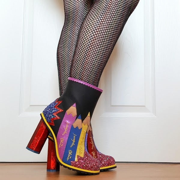 wearing rainbow fishnet tights and pencil themed blackboard ankle boots with chalk