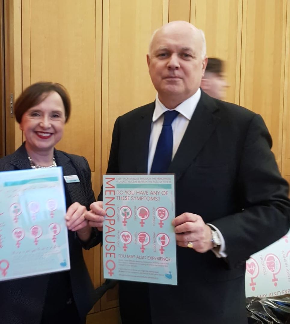 Liz Carr-Ellis with Iain Duncan Smith MP and their Pausivity posters