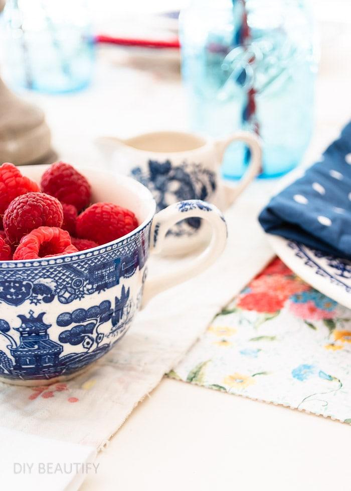 raspberries in vintage blue teacup
