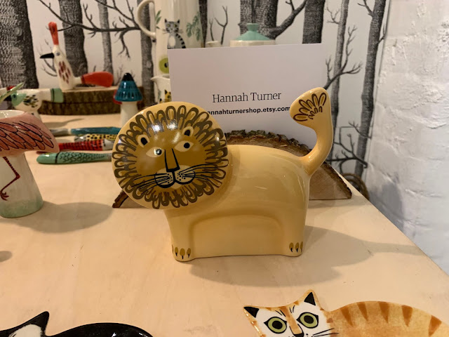 A ceramic lion money box by Hannah Turner from Etsy