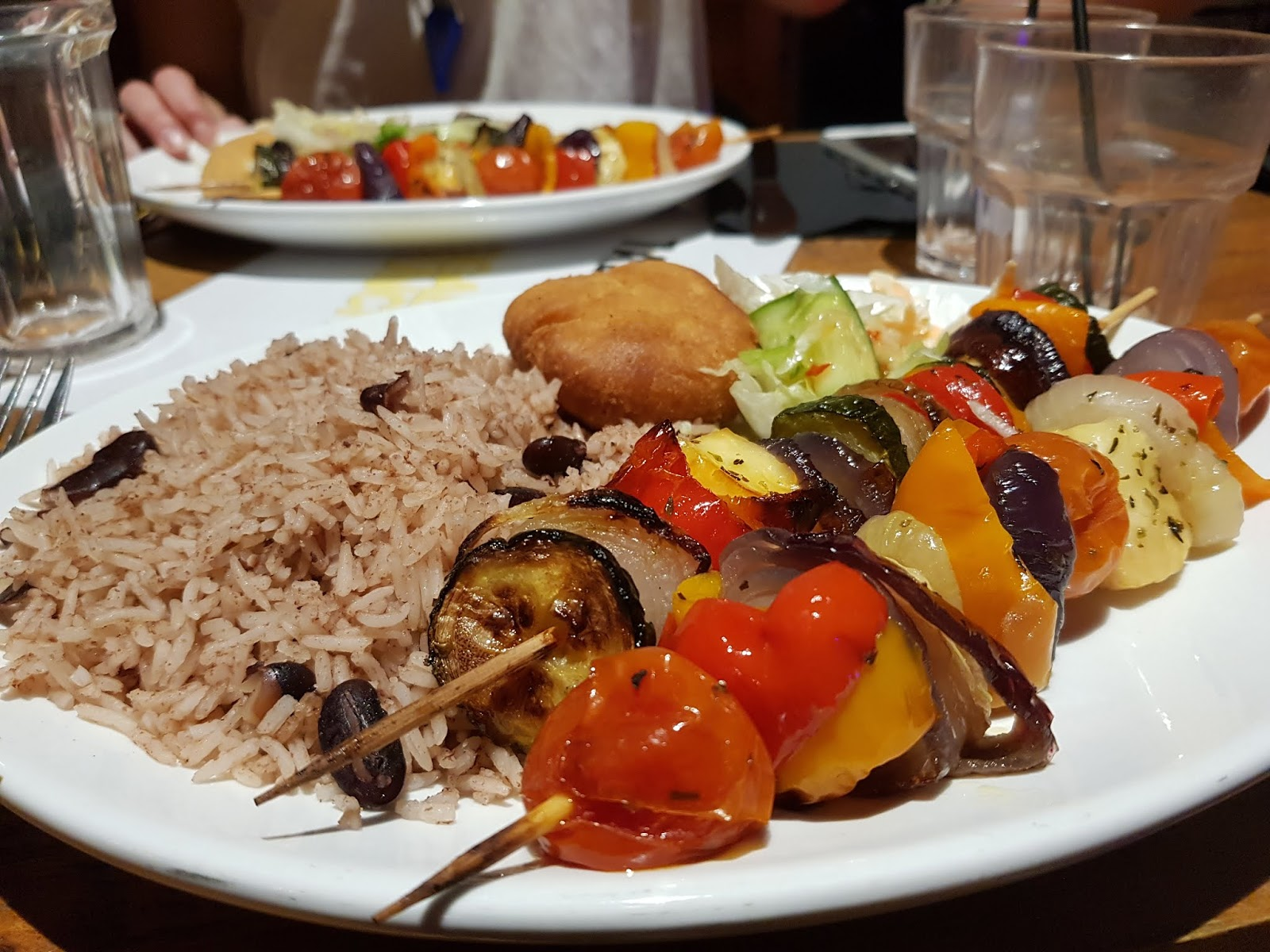 Reggae Brunch vegetarian main course: Grilled Vegetable and Halloumi skewers, rice and peas, side of coleslaw, mixed salad and dumpling