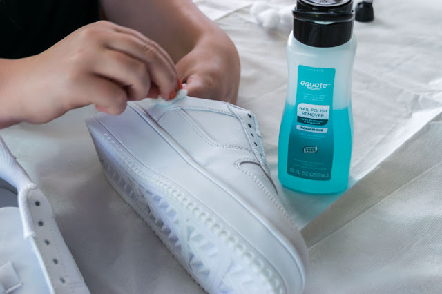 cleaning off the shoes with acetone