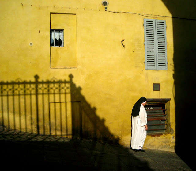 a nun leaving the sanctuary of Saint Catherine in Siena