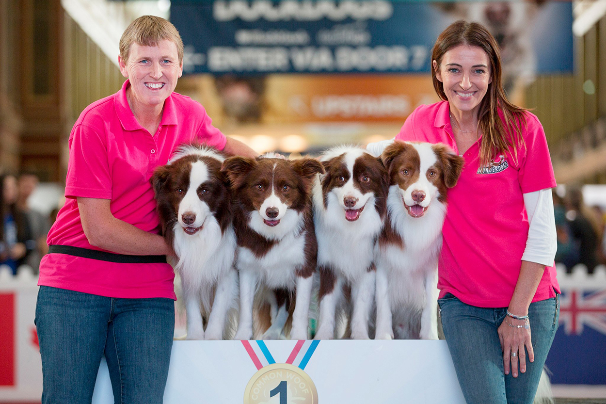 Kelly Gill and the Wonderdogs Border Collies sit on a podium with Dr Katrina Warren