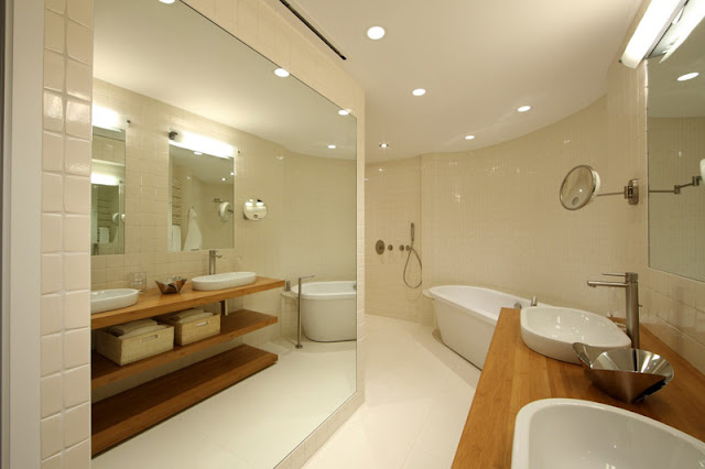 warm wood and white ceramic bathroom