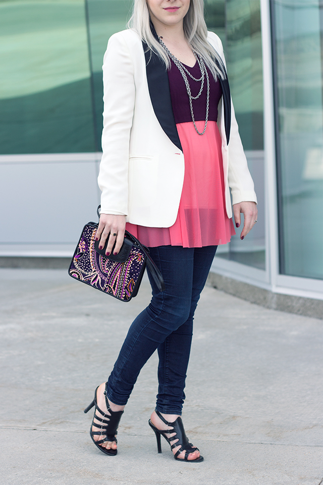 Tuxedo blazer with coral top and paisley clutch.