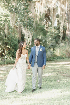 bride and groom walking at lake mary events center