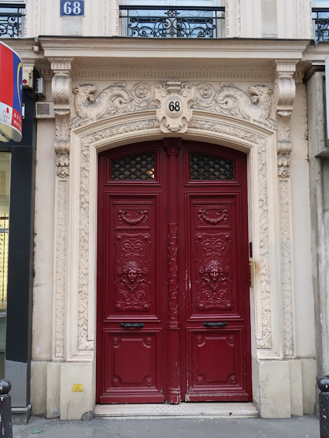 Stone building with a large red double doorway