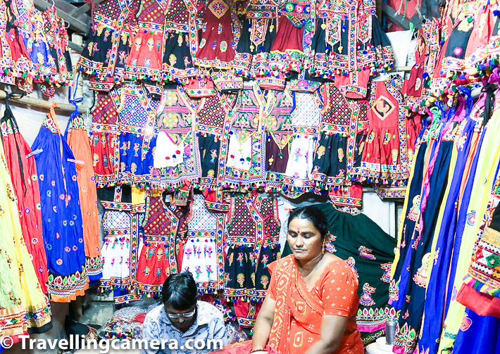 There is this one road which is full of road-side shops selling colorful chaniya-choli during Garba nights. I tried to ask if that's what is sold throughout the year or it's seasonal. I sensed that it was mainly because of Navratri celebrations, when lot of people buy Chaniya Choli and that's how people dress before going to Garba grounds across the state. Lot of folks from outside Ahmedabad come to the city to do Garba shopping. Shops remain their and then they change the stocks and focus on things which are in demand throughout the year and certainly keep changing as per weather & seasons.     Related Blogpost from Gujrat - Travelling Camera in Gujarat || Exploring old Ahmedabad on foot