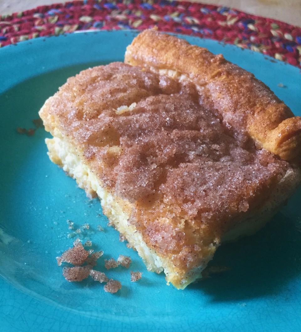 Sopapilla Cheesecake with cinnamon-sugar topping
