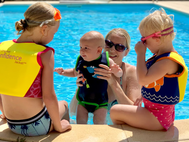 Happy times on holiday with 3 children in the swimming pool in the sunshine