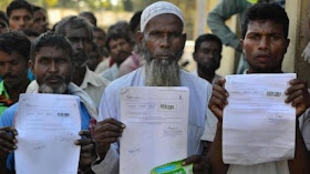 Image Attribute: The file photo of people getting their official documents checked ahead of the release of the final draft of NRC at a Seva Kendra in Guwahati. /Source: PTI / Dated: July 29, 2018