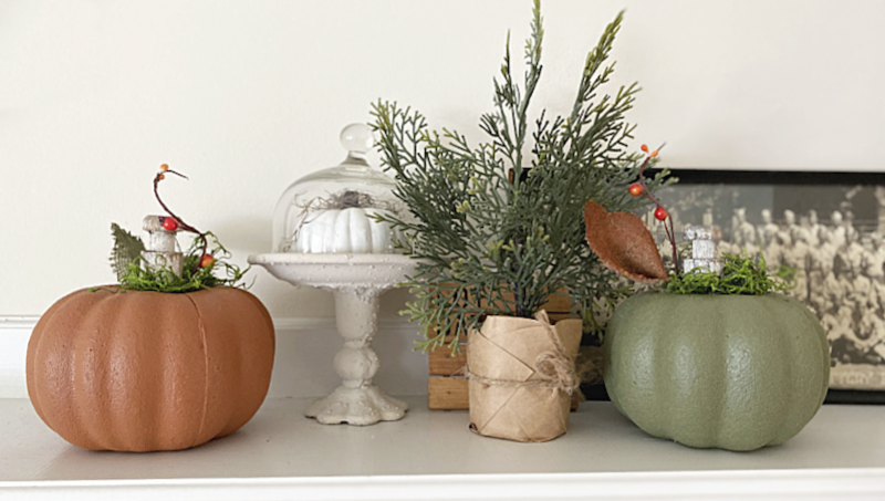 painted pumpkins on the mantel